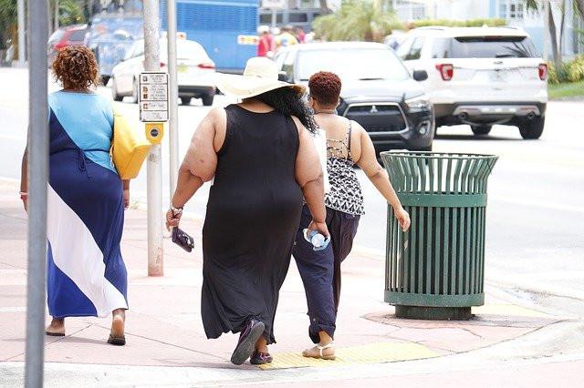 three obese women walking down the street