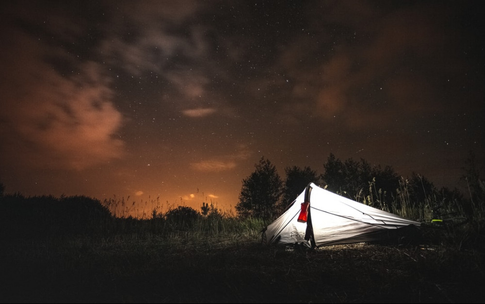 sleeping in a tent, free in nature