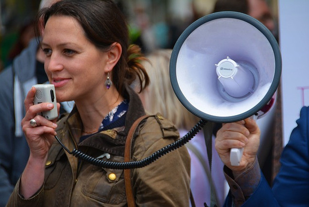 woman speaking with megaphone