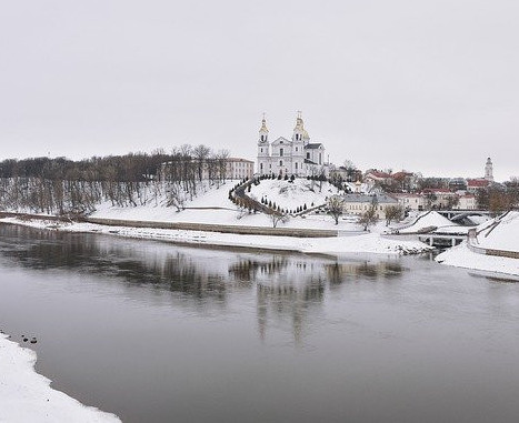 river in winter, csnowcovered castle in the background
