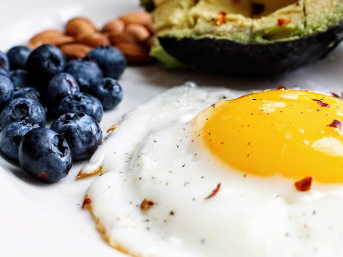 Keto diet, a baked egg and blueberries, avocado