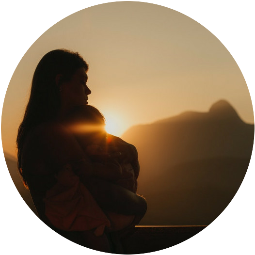A woman sitting peacefully at sunset gazing off into the mountains thinking about her business. If you click this image, it will take you to an Amazon page with meditational products to help with meditation and focus on your business.