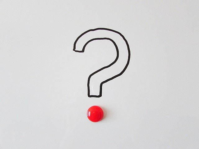 Image of a question mark drawn in black marker with a red dot