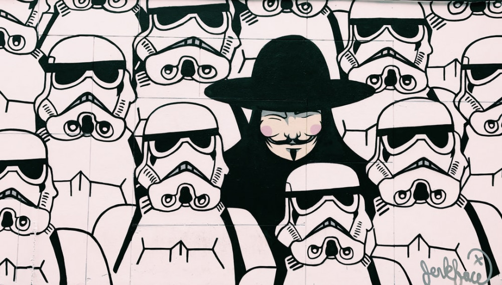 Image of a mural showing a group of stormtroopers with V (from V for Vendetta) standing among them