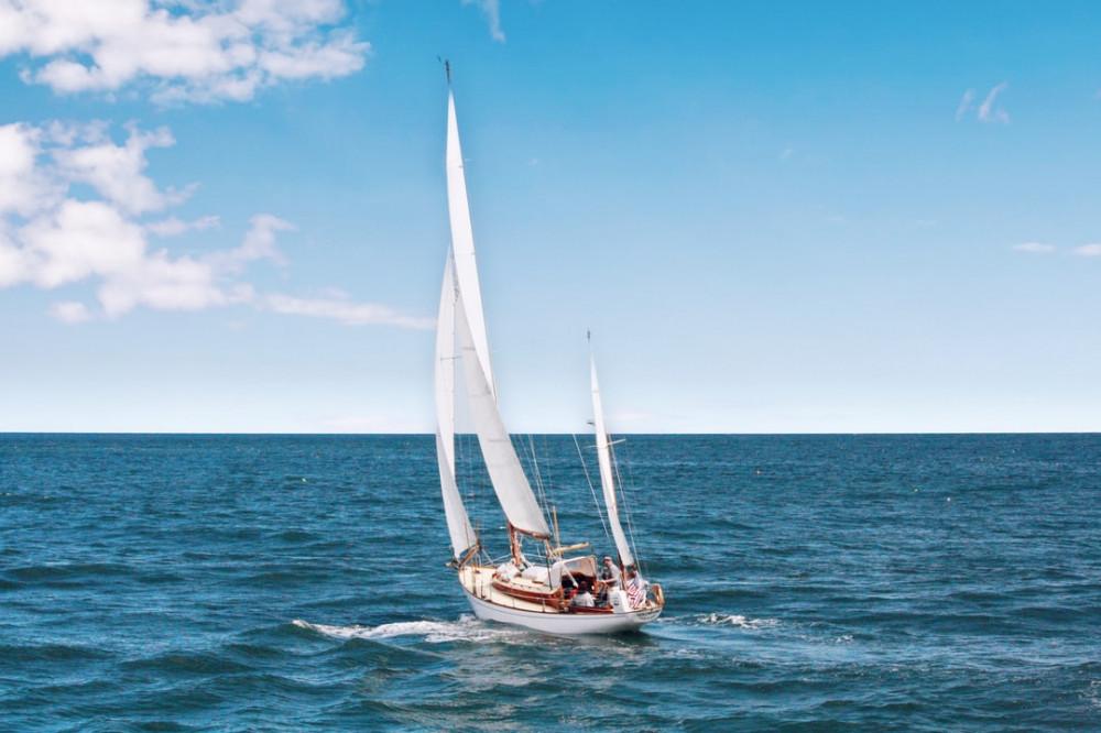 Sailboat traversing the ocean