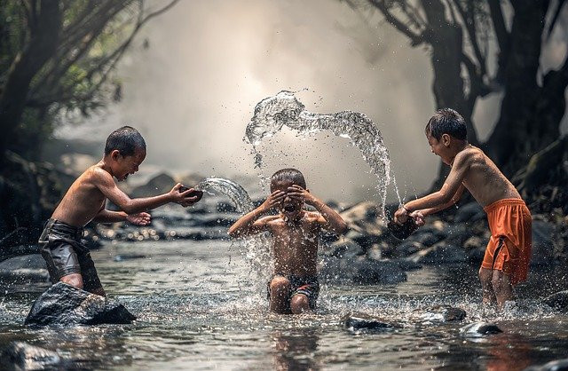 Children playing in pond