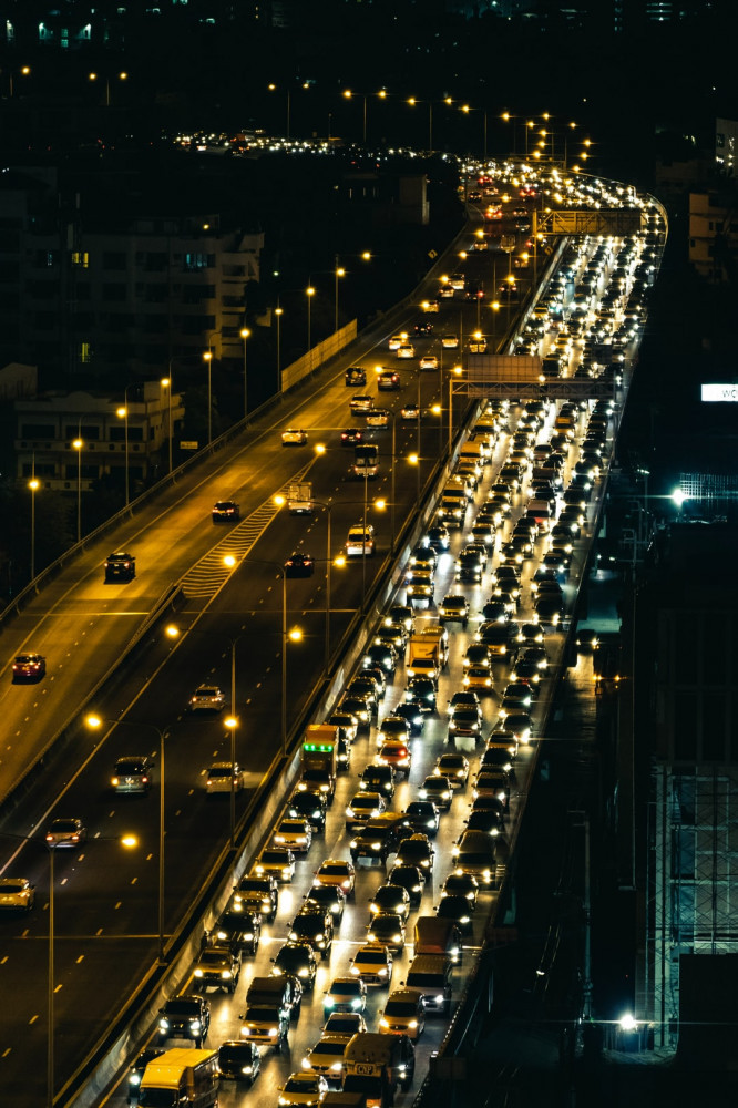 Image shows a congested city highway at night.