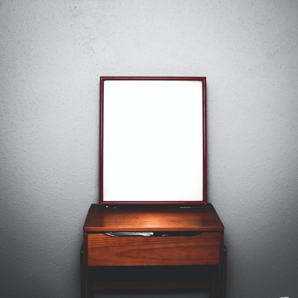 Image showing a simple wooden dresser with a rectangular mirror