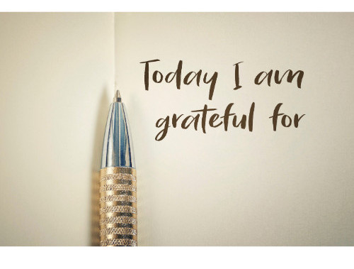 """Open journal with """"Today I am grateful for"""" written on it"""
