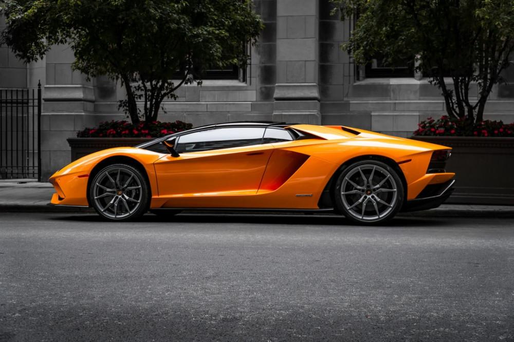 Orange Lamborghini parked on a city street