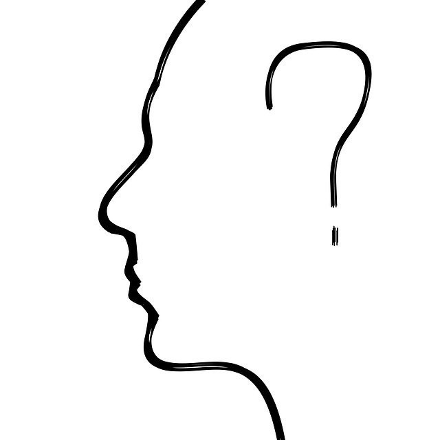 Outline of a head with a question mark inside