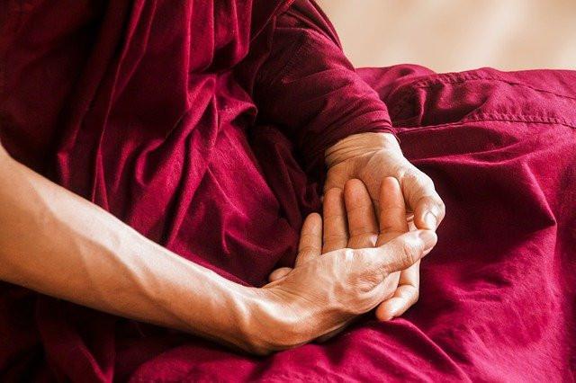 hands folded in lap