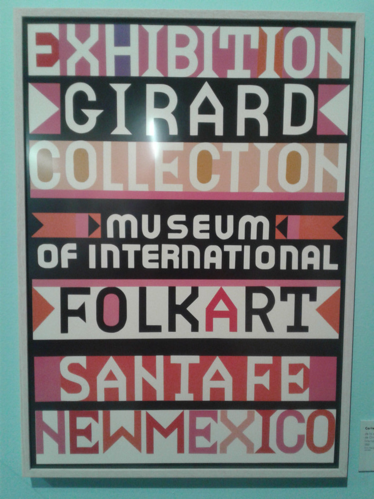 Image shows a poster designed by Girard for an exhibition showcasing his collection of popular art in Santa Fe, New Mexico