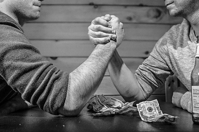 Two men arm wrestling