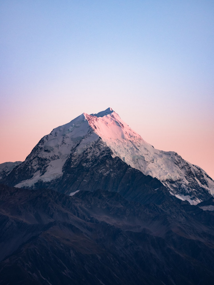 Image shows a mountain peak covered in snow