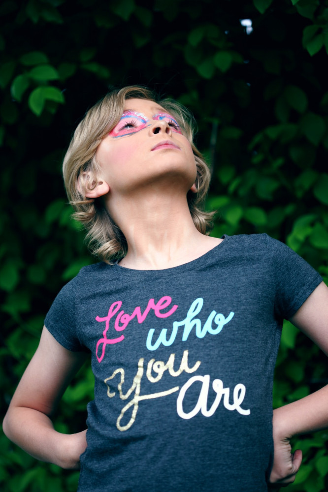 """Girl wearing a shirt that says """"Love who you are"""""""