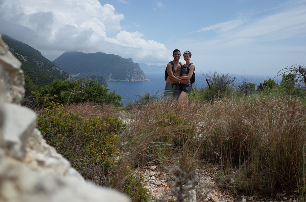 An image of me and Petra on a hike in Corfu, a Greek island, with the ocean in the background