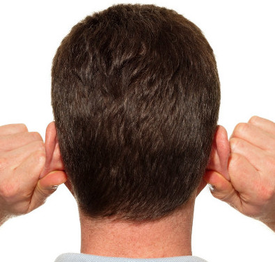 man massaging his ears