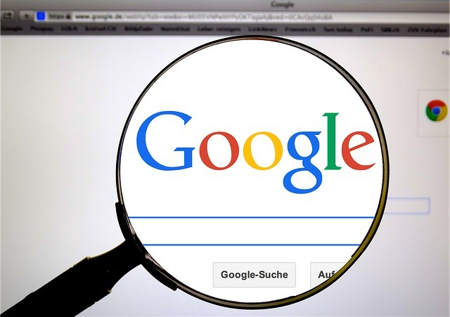 Magnifying Glass Over a Google Search Page