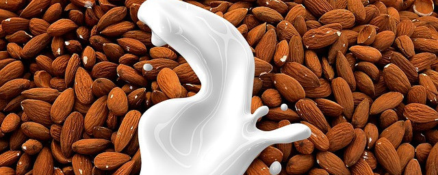 Pouring milk over almonds