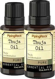 Two bottles of Thuja oil