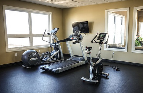 a treadmill and station bikes