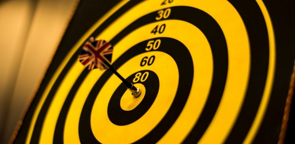 Image of bulls-eye target with dart in middle