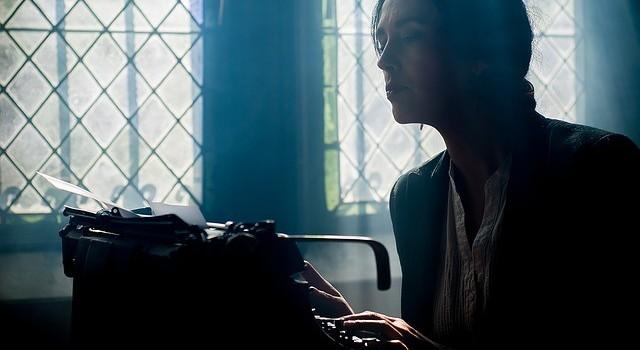 Image of woman at tiypewriter typing