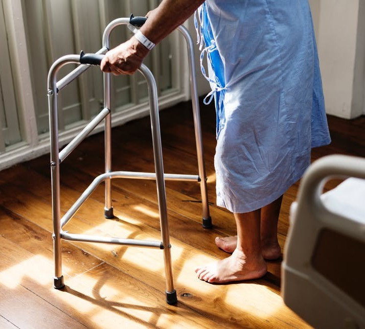 Senior using a walker image