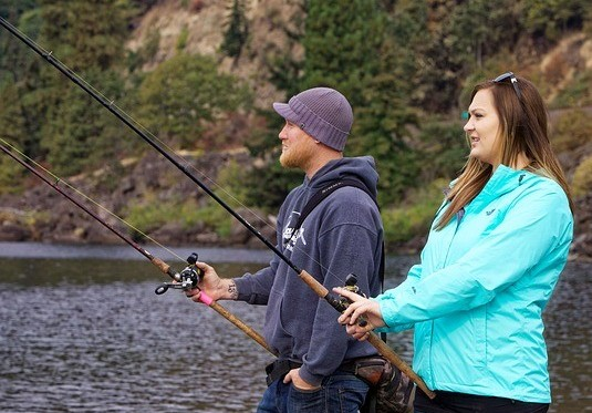 Image of man and woman fly fishing