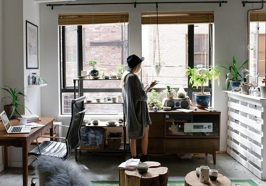 Image of woman in decorated office area