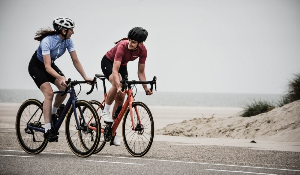 Image of two women biking