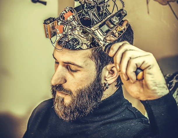Image of a man with electronic brain and wiring