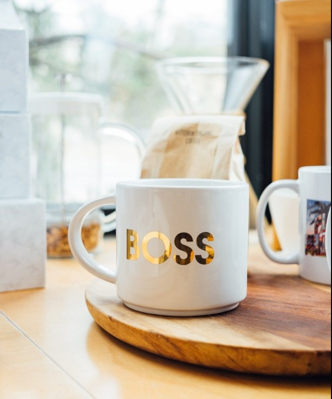 "Image of coffee cup with ""Boss"" printed on it"