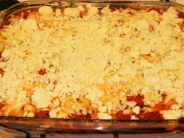 Grated chedar cheese and sheep cheese on the top of the best eggplant casserole