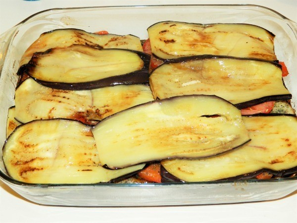Fifth layer of eggplant casserole is sliced eggplant