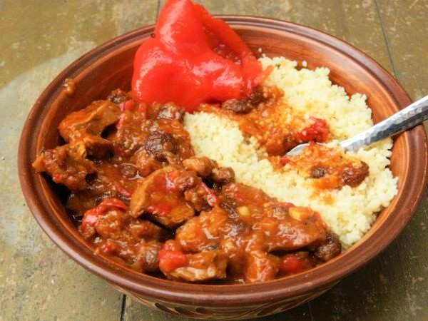World best lamb stew with raisins served with couscous and pickled swet pepper