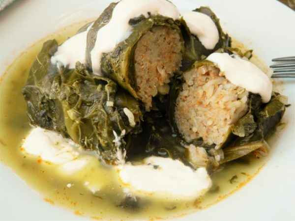 Best Stuffed Collard Greens Recipe-Served on Plate With Sour Cream