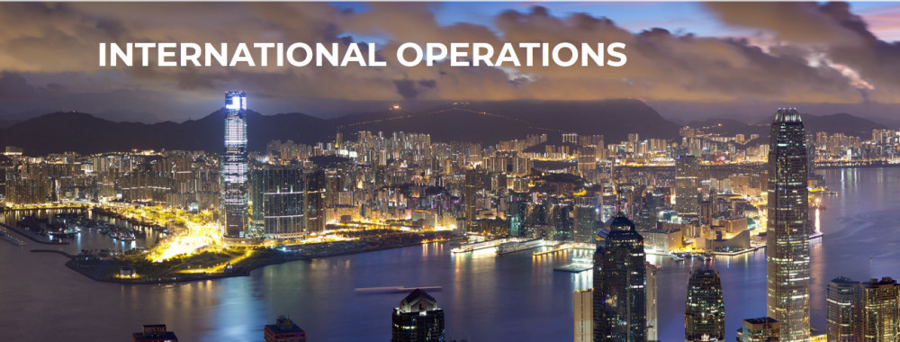 Aeiral image of a port area with words 'International operations,' to signify NHT Global