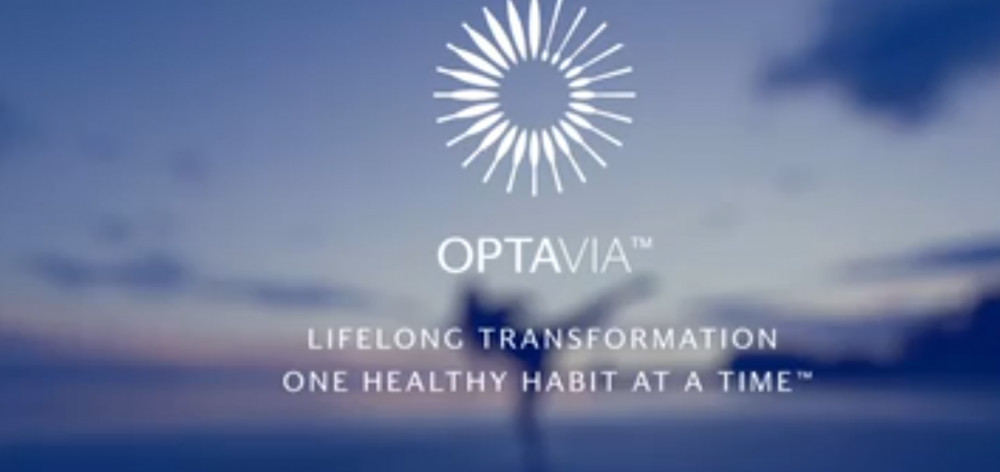 Optavia official website homepage with a stellar image and words 'Optavia, lifelong transformation one health at a time'