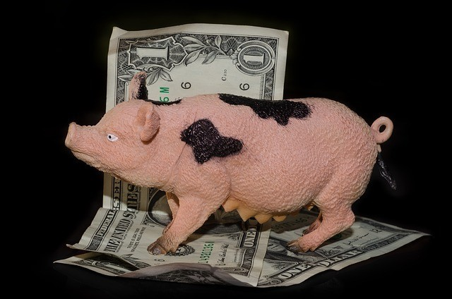 A pig toy and one dollar bills to signify 88 Ways for Making Money Online at Home Free (Part III)
