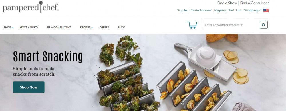 Pampered chef official website homepage with words 'Smart snacking and some herbs and snacks on a table