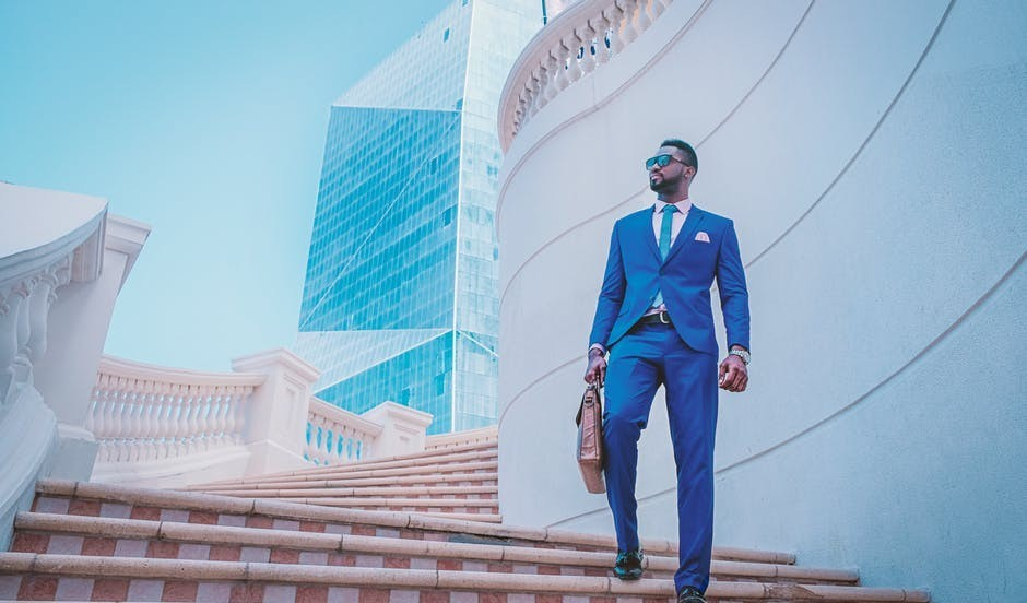 A well-dressed, bag carrying young man in blue suit to signify 5 Winning Strategies for MLM Success