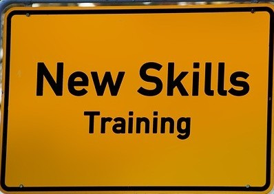 A yellow sign reading NEW SKILLS Training to say Advertise Your Other Skills