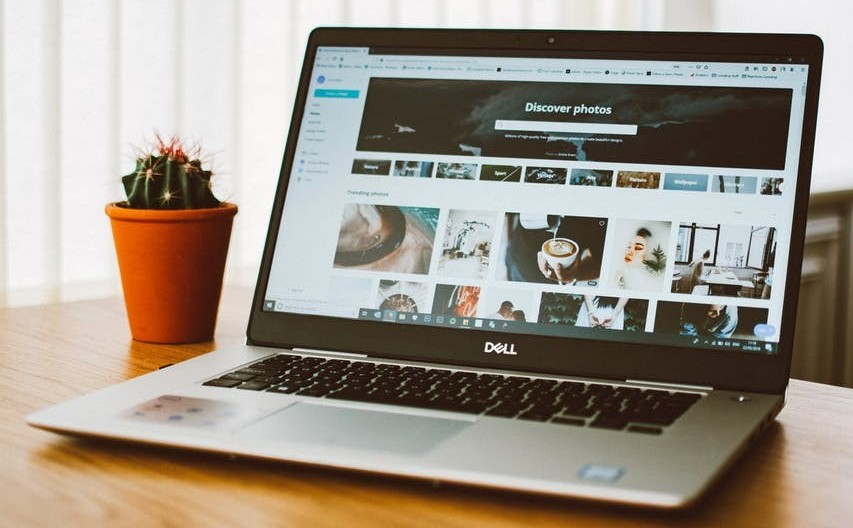 A website for photos on a laptop to show create your own two free wordpress websites at wealthy affiliate with SiteRubix