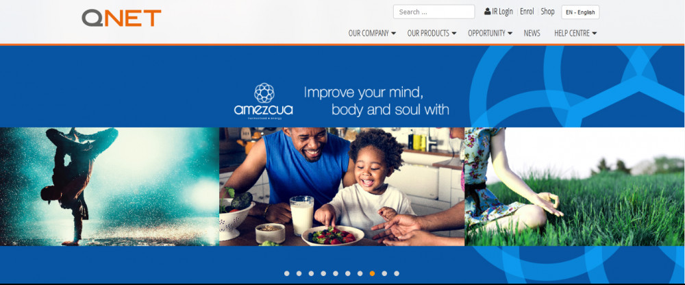QNET's official website homepage showing a man and child at table and words 'improve your mind, body and soul with...'