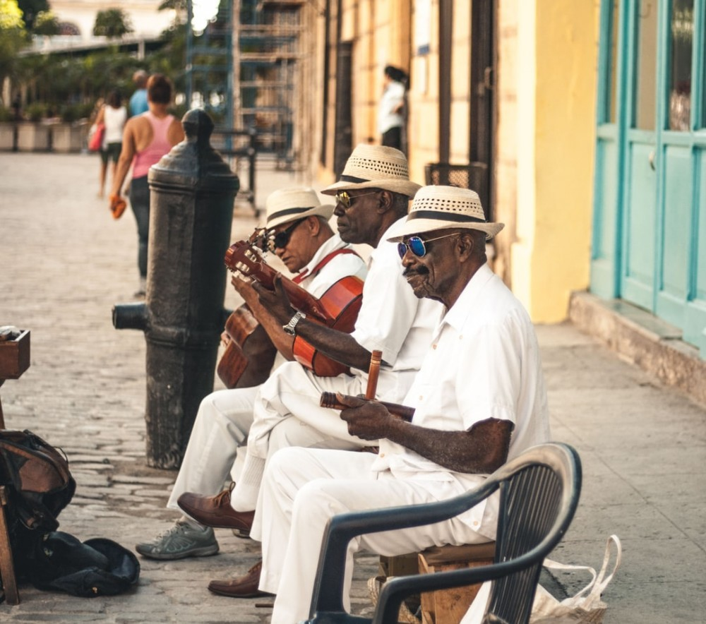 Musicians playing in the street to signify Busking as creative ways to make money