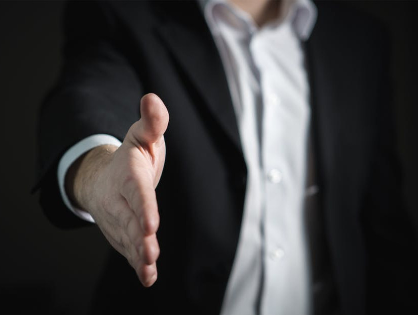 Man with outstretched hand ready to shake another to signify Affiliate Marketing: Different Types