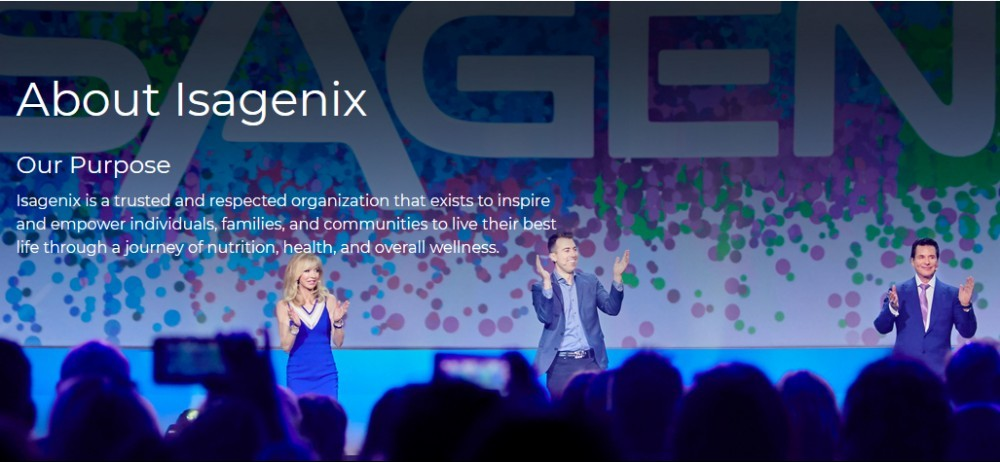 Isagenix about us showing a blue image with 3 clapping people before a crowd