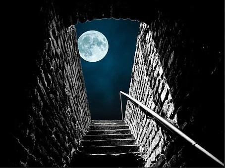 Stairs leading up to the clear moonlight sky